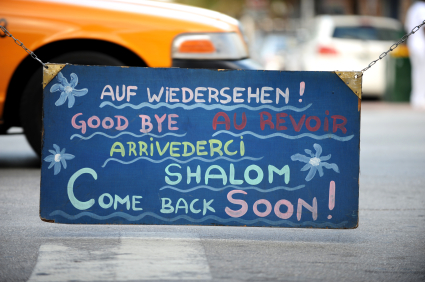 Goodbye Written in Several Languages on Sign