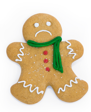 Sad gingerbread man with scarf and buttons
